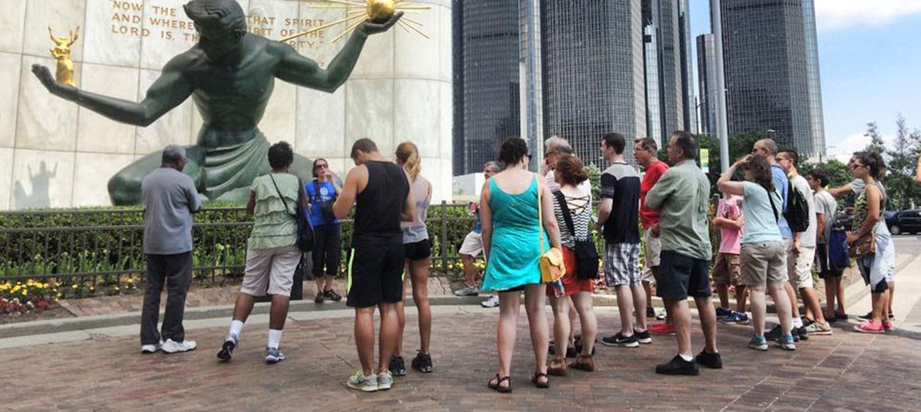 Detroit Experience Factory Tour by Spirit of Detroit statue