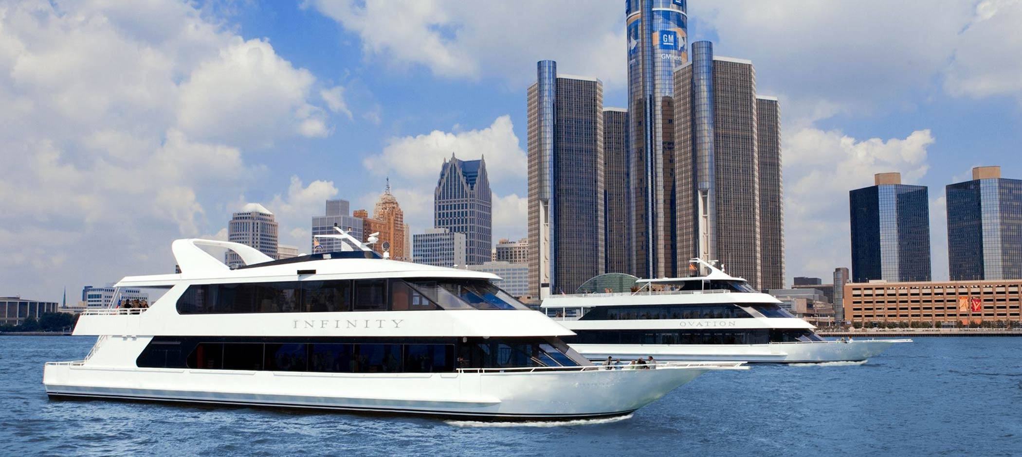 Infinity Ovation Yacht Charters with downtown Detroit