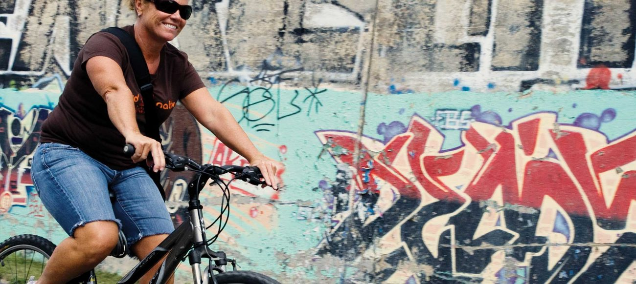 Bicyclist with grafitti wall
