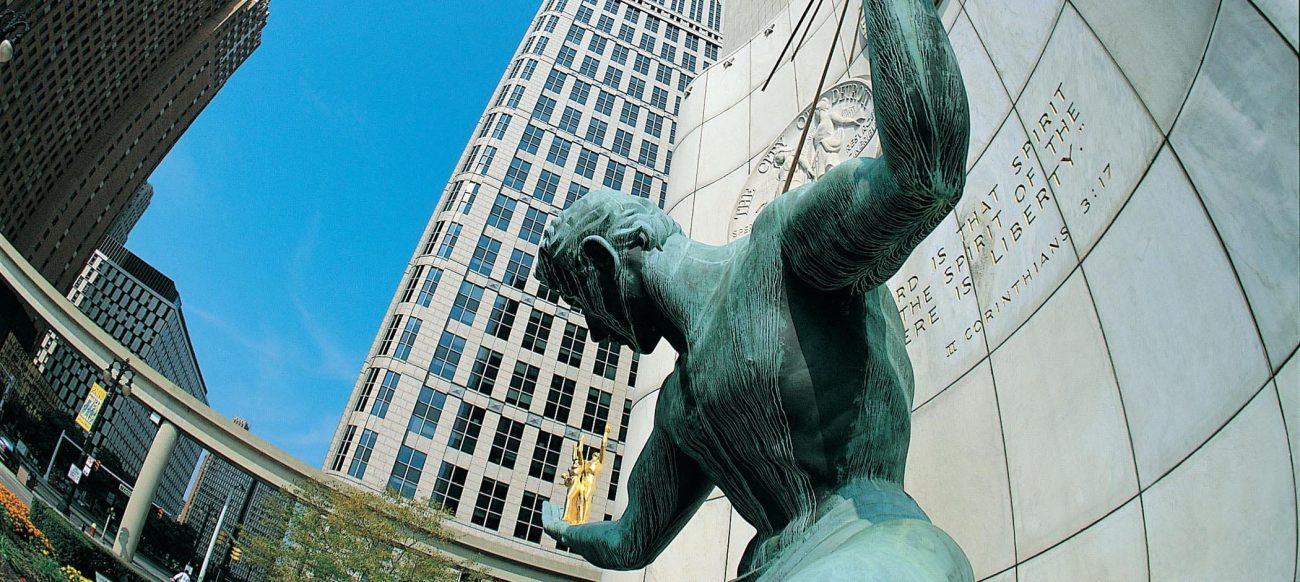 Spirit of Detroit sculpture with buildings