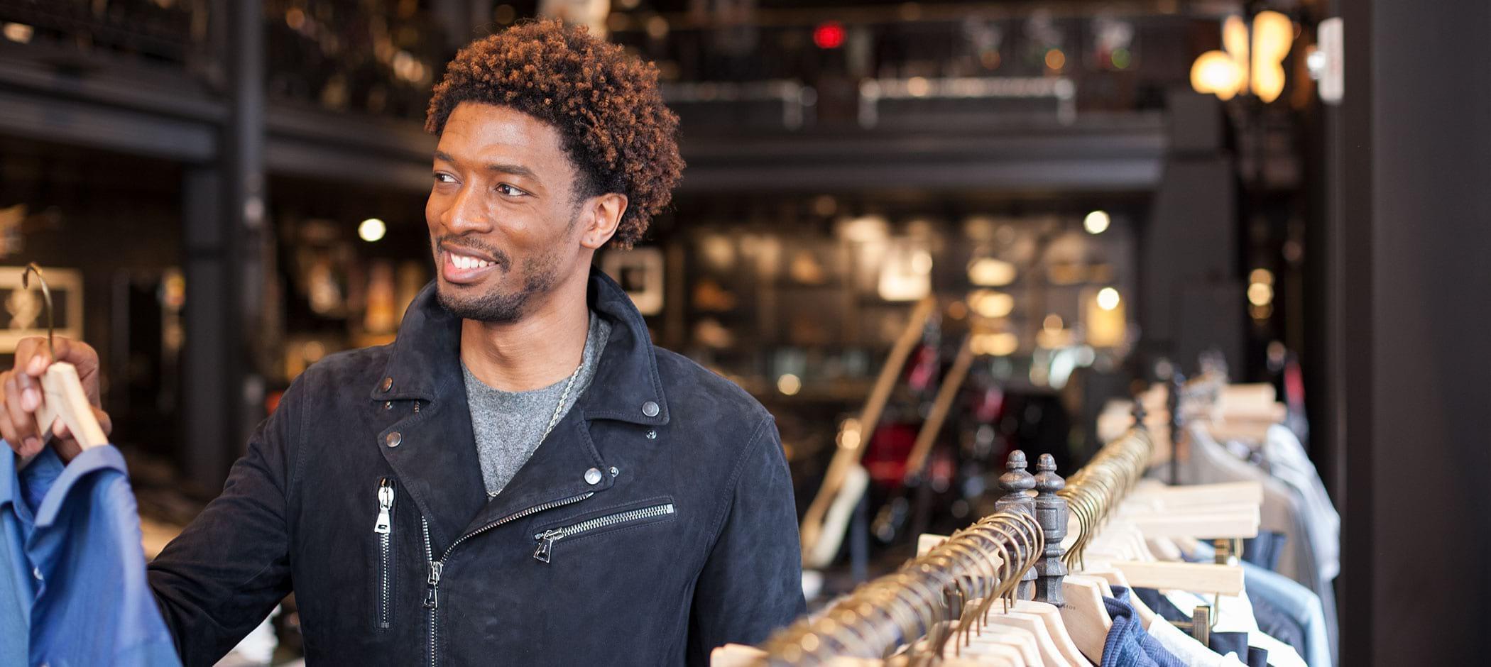 Man shopping at John Varvatos in Detroit