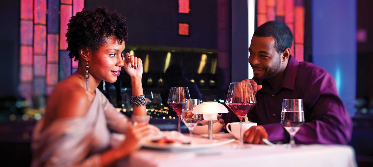 Couple at dinner at Iridescence during a romantic getaway in Michigan
