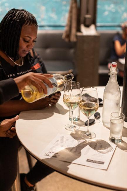 Detroit vineyards tasting room wine pour